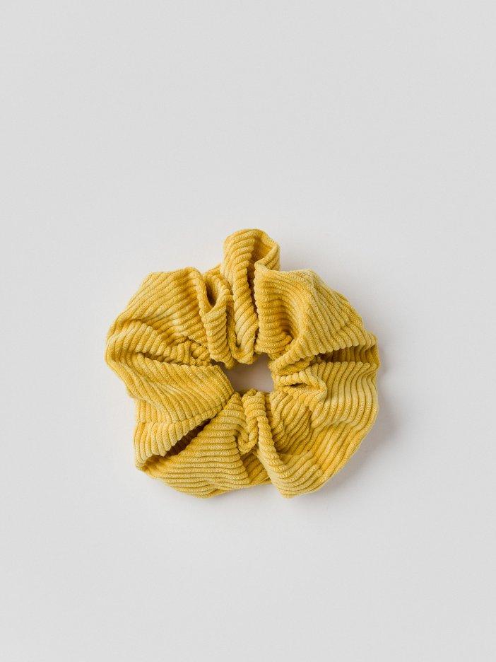 Žltá gumička Delly